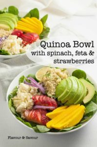 Healthy Quinoa Bowl with Spinach, Feta and Strawberries, Avocado and Mango