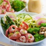Grilled shrimp, raw zucchini noodles and crisp vegetables all drizzled with an intensely flavourful sesame miso vinaigrette makes this Fresh Veggie and Grilled Shrimp Zoodle Bowl a nutritious lunch or a light dinner