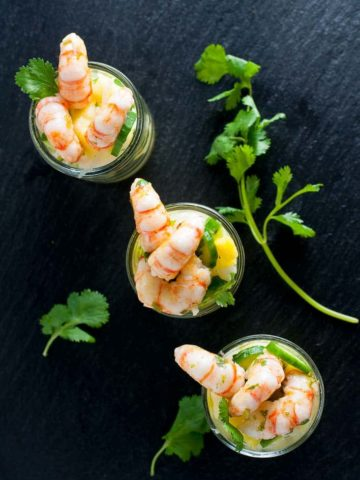 three small cocktail dishes with prawn cocktail and pineapple jicama salad