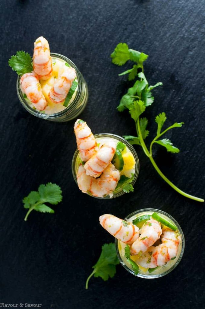This Grilled Prawn Cocktail with Pineapple Jicama Salad combines pineapple, cucumber and jicama with a tangy cilantro lime dressing. Top with fresh prawns or shrimp.