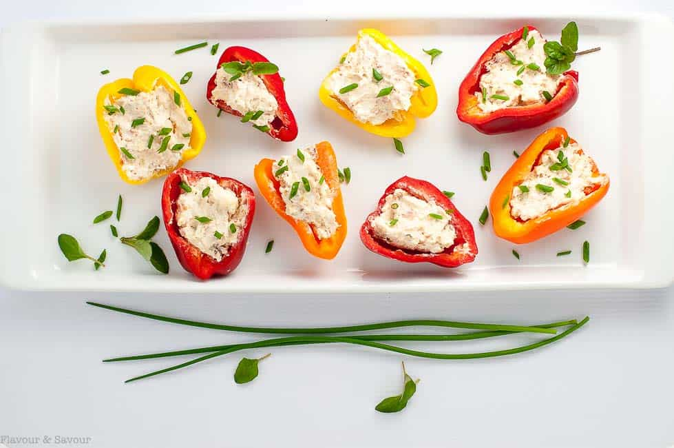 easy appetizer of Sun-dried Tomato, Artichoke and Cheese Stuffed Mini Peppers.