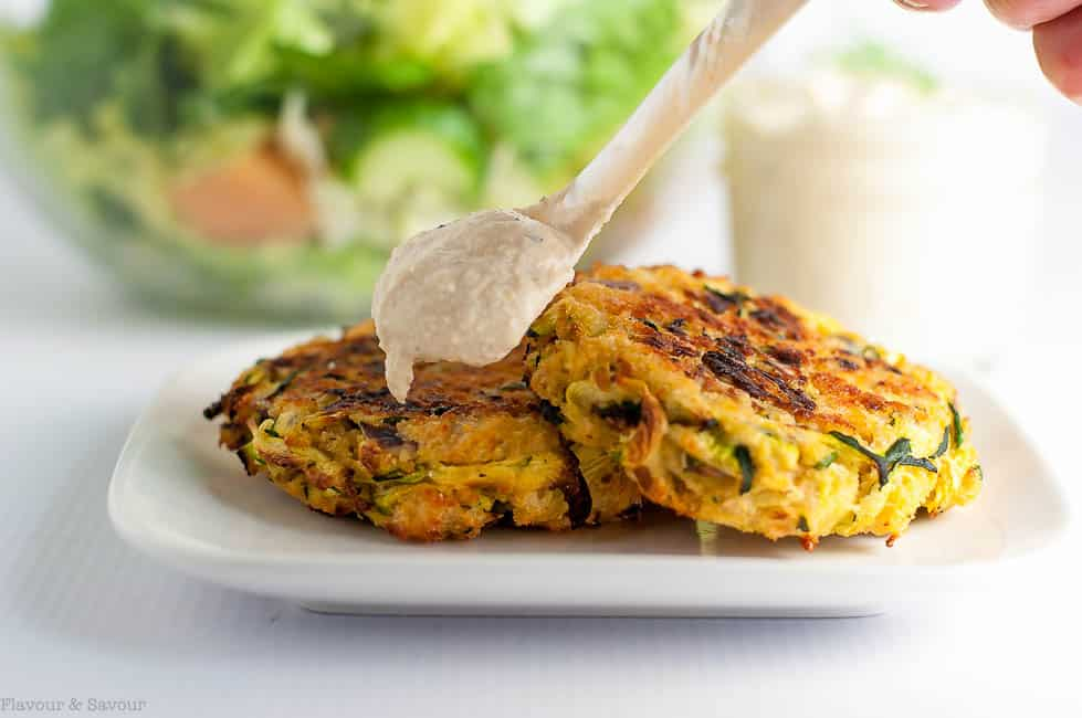 Crispy Baked Zucchini Patties with a spoonful of lemon tahini dip