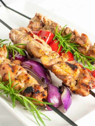 These Grilled Rosemary Mustard Chicken Kabobs are tender bites of chicken, glazed with fresh rosemary and a mixture of Dijon and grainy mustard.