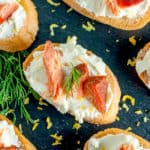 Smoked Salmon Crostini on a black slate board
