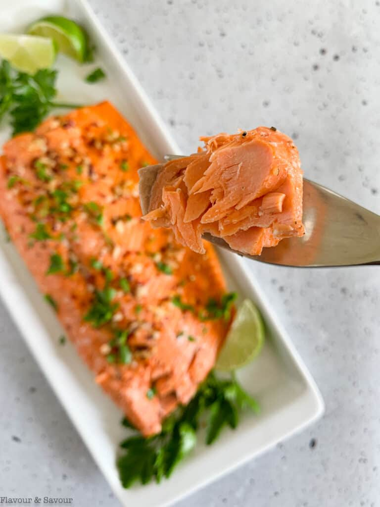 A forkful of baked salmon