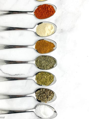 spoons with spices for Cajun seasoning mix
