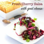 Fresh Cherry Salsa on a log of goat cheese served with rice crackers.