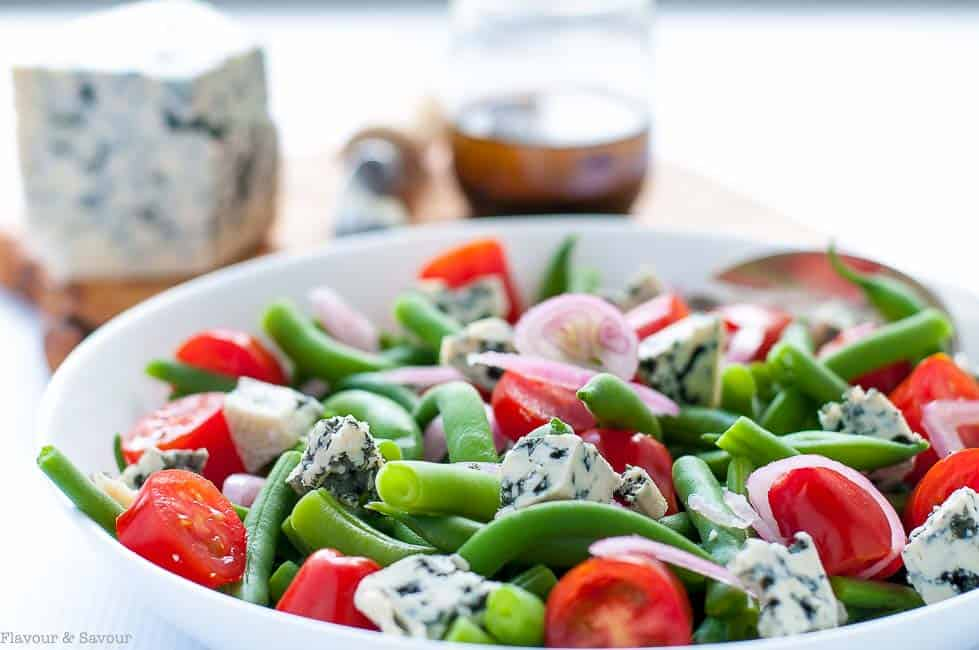 Crisp-tender fresh green beans, sweet cherry tomatoes, spicy shallots and sharp blue cheese combine to make every mouthful of this Green Bean Blue Cheese Salad an adventure!
