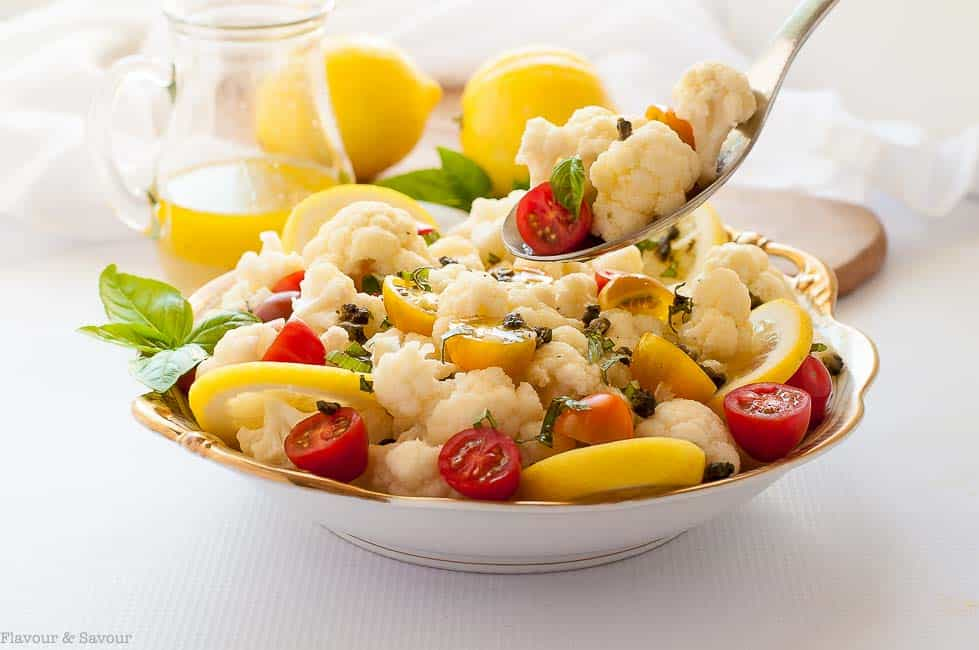 Taking a spoonful of Cauliflower Lemon Basil Salad