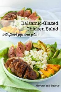 Balsamic Glazed Chicken Breasts with fresh figs, feta cheese, sliced avocado and sliced peaches in a bowl of greens.