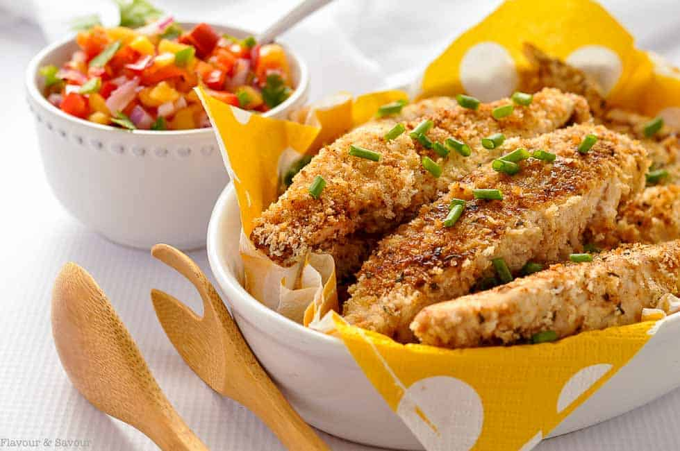 Cajun Chicken Strips in an oval bowl with a yellow napkin