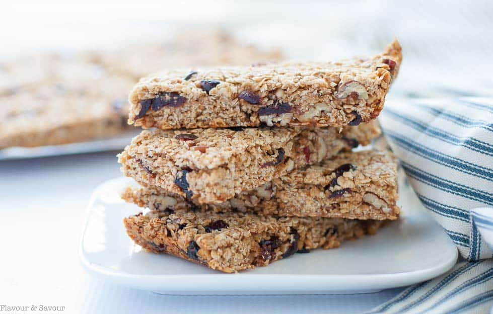 These Chewy Cranberry Pecan Oat Bars are naturally sweetened with honey and coconut palm sugar. They're a perfect make-ahead bar as they freeze well. |www.flavourandsavour.com