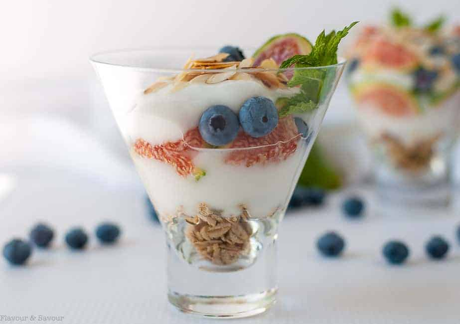 Start your day with this cheerful Fresh Fig Yogurt Breakfast Parfait by layering granola, yogurt, fresh sliced figs, blueberries, almonds and a drizzle of maple syrup or honey.