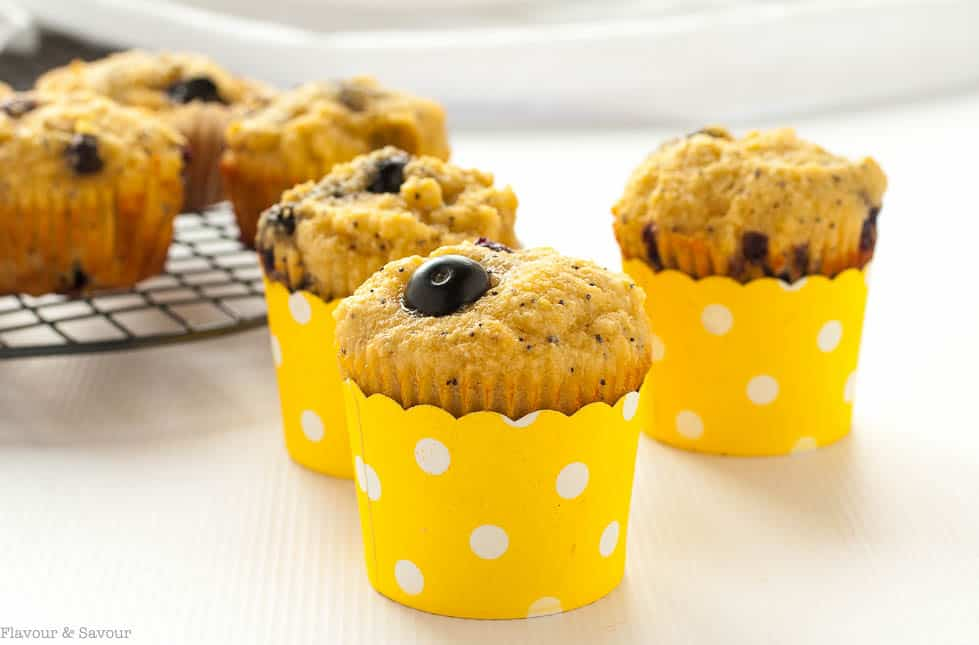 Paleo Blueberry Lemon Poppy Seed Muffins in yellow polka dot cups.