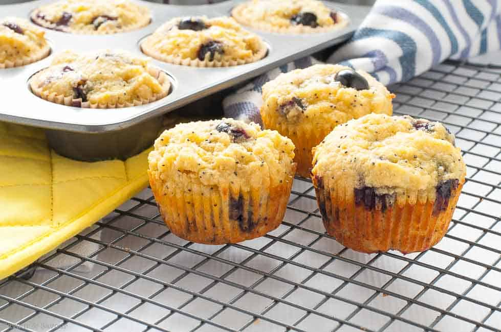 Paleo Blueberry Lemon Poppyseed Muffins cooling on a rack.