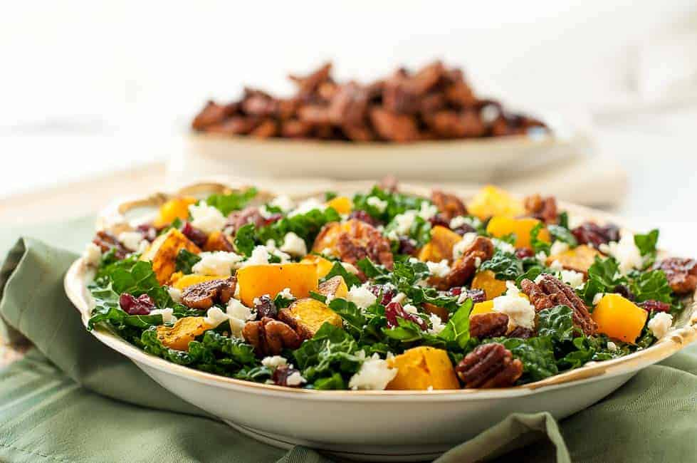 Butternut Squash Salad with Cranberries, Kale and Feta on a green cloth