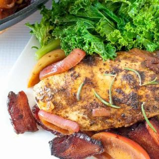 This One-Pan Spiced Apple Chicken with Bacon and Onions is sweet and smoky, tender and juicy! Perfect for a fall or winter dinner. #paleo #chicken #recipe