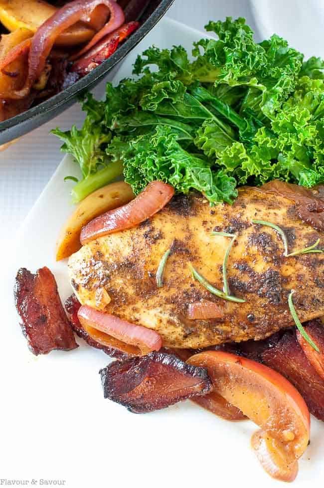 This One-Pan Spiced Chicken with Apples, Bacon and Onions is sweet and smoky, tender and juicy! Perfect for a fall or winter dinner.