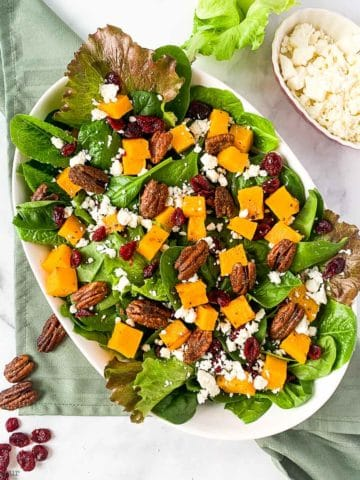 Overhead image of Spinach Salad with Roasted Butternut Squash, Cranberries and Feta