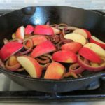 onions and apples browning for Spiced Chicken with Apples and Bacon