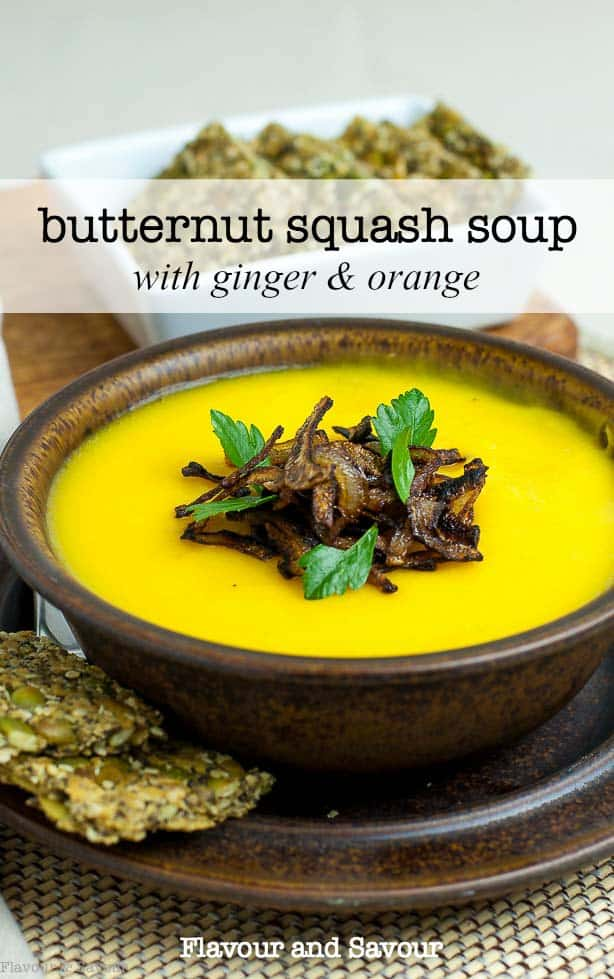 Smooth and silky, warm and comforting, this is no ordinary Butternut Squash Soup! Fresh ginger and orange juice add zesty interest to this paleo, dairy-free soup. Top with crispy shallots. #butternut #squash #soup #vegan #ginger #orange #dairyfree