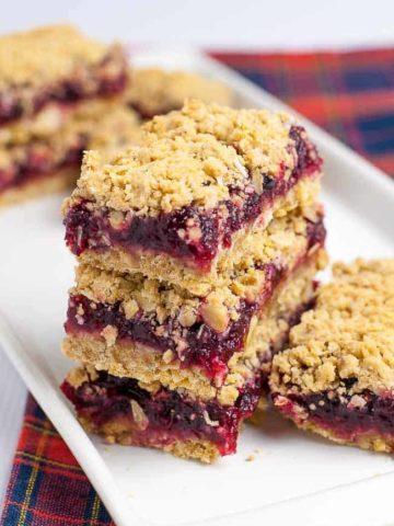 Bursting with cranberries with hints of lemon, these Gluten Free Cranberry Lemon Oatmeal Bars have a buttery oatmeal base and a crumbly coconut topping.