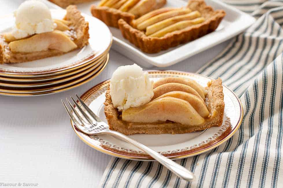Gluten Free Cinnamon Pear Tart with Caramel Sauce on a plate with ice cream