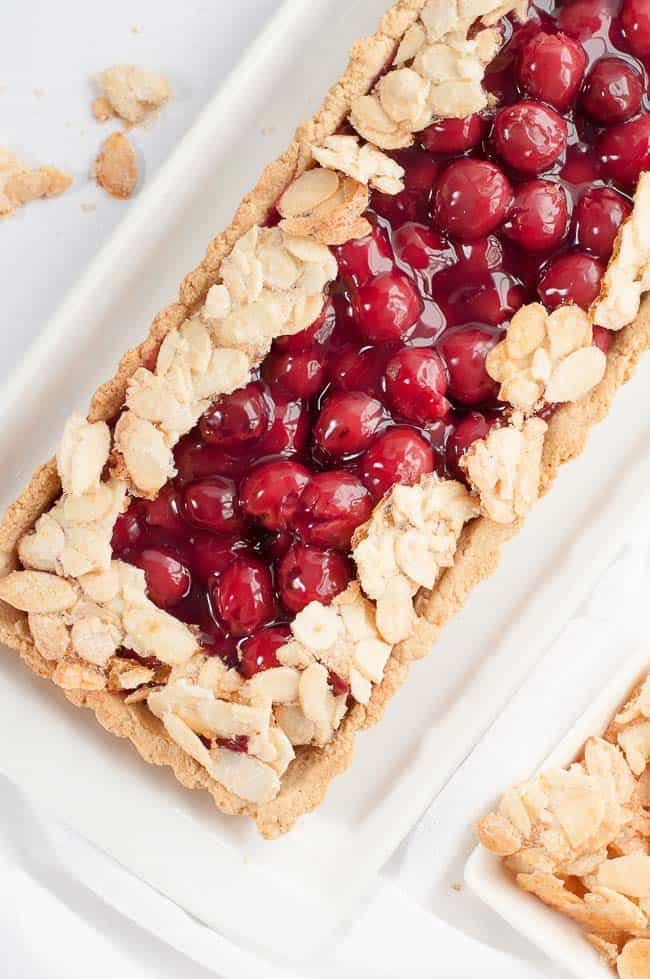 This Sour Cherry Almond Tart is gluten-free, it's just sweet enough, and it's an easy dessert to make for your next party! |www.flavourandsavour.com