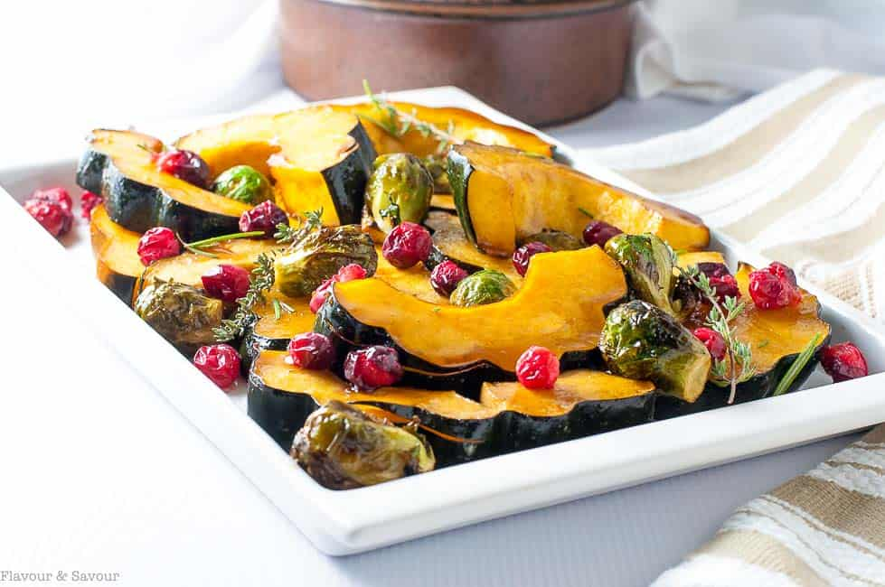 Honey balsamic roasted acorn squash with Brussels Sprouts and roasted cranberries.