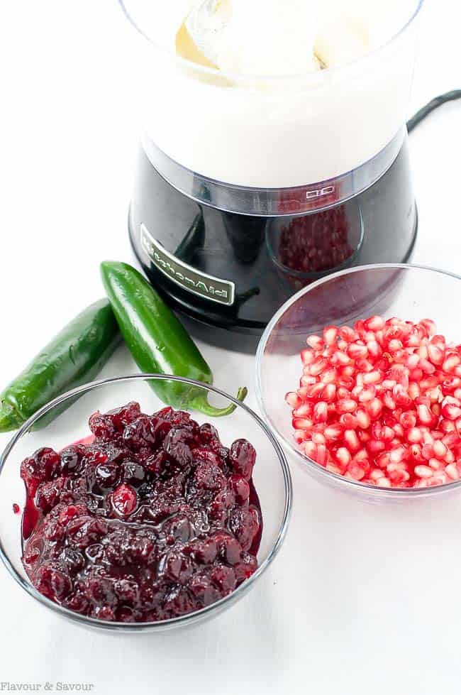 Ingredients for Cranberry Jalapeño Whipped Feta Dip include leftover cranberry sauce, pomegranate arils, jalapeño peppers, feta cheese and cream cheese