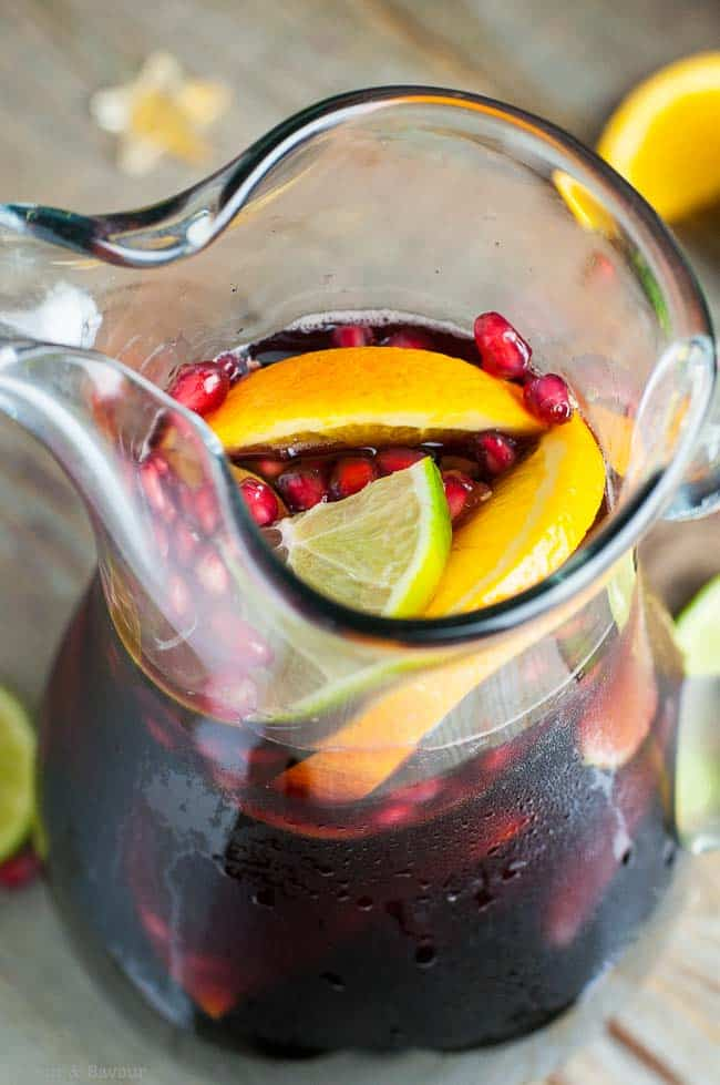 Red Wine Citrus Pomegranate Sangria in a pitcher, ready to serve