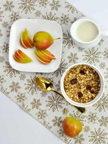 A bowl of Gingerbread Spiced Granola with Forelle pears