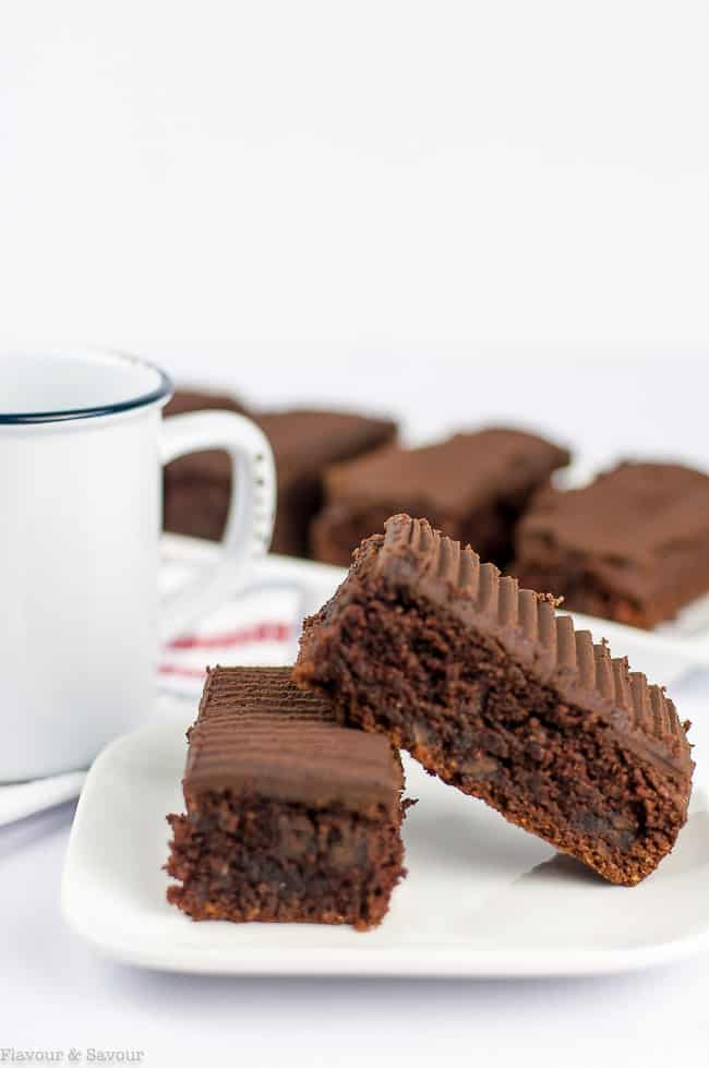 Grain-Free Amaretto Brownies with Chocolate Ganache with a coffee cup