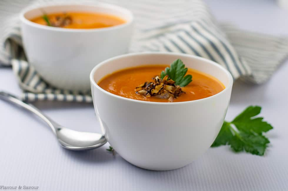 Instant Pot Carrot Ginger Soup with Apple and garnished with crispy shallots and fresh herbs