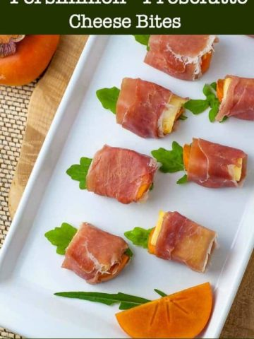 Persimmon Prosciutto Cheese Bites on a white serving tray