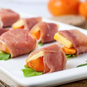 Close up view of Persimmon Prosciutto Cheese Bites