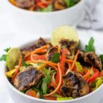 Easiest Chicken Satay Salad garnished with lime and cilantro