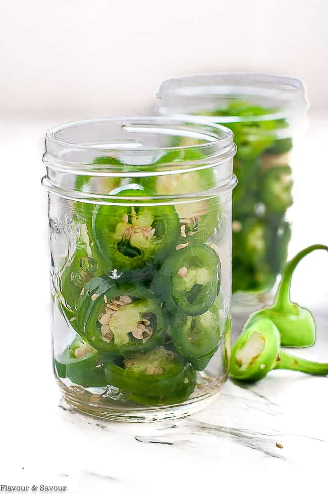 Jalapeño pepper rings in two 8 ounce Mason jars