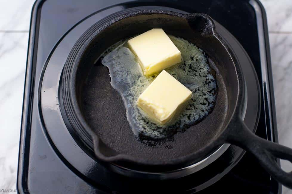 Melting butter for Caribbean Rum Bananas Flambé with Amaretto