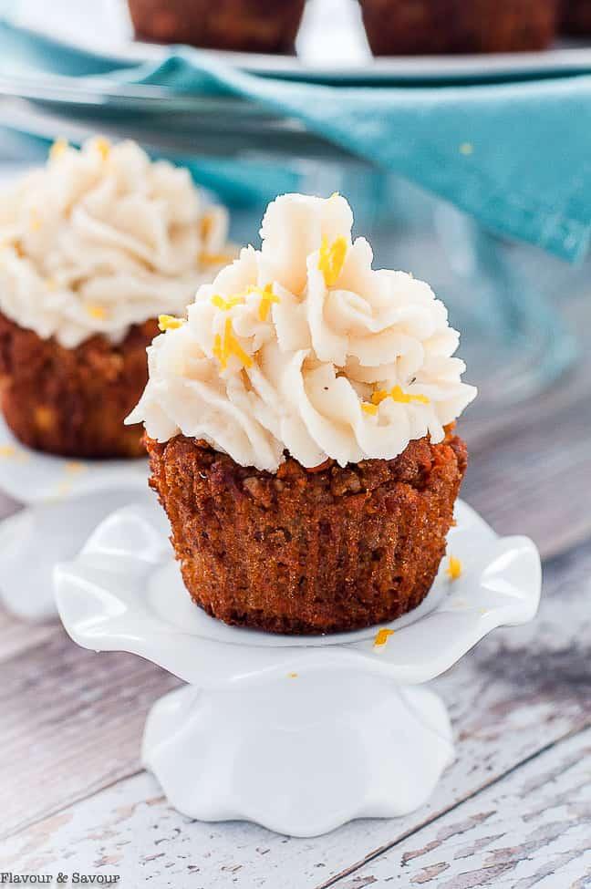 Grain-Free Carrot Cake Cupcake on a cupcake pedestal