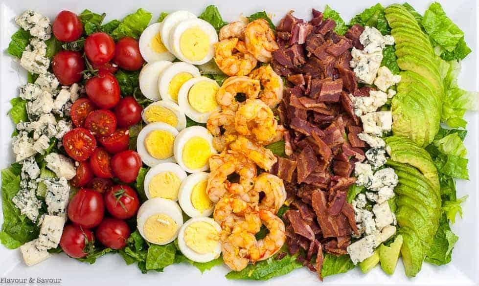 Lemon Garlic Shrimp Cobb Salad on platter. Overhead view.