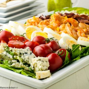 Side view of Shrimp Cobb Salad on a platter with ingredients in rows