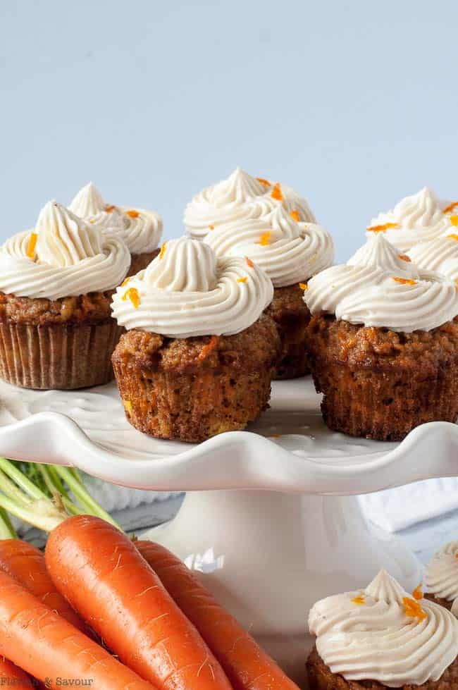 Mini Gluten-Free Carrot Cake Cupcakes with cream cheese frosting with fresh carrots
