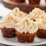 Mini Gluten-Free Carrot Cake Cupcakes with Cream Cheese Frosting on a plate.