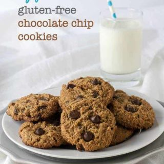 My Favourite Gluten-Free Chocolate Chip Cookies on a plate with a glass of milk