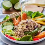 Pouring Citrus Vinaigrette on Caribbean Shredded Jerk Chicken Salad_
