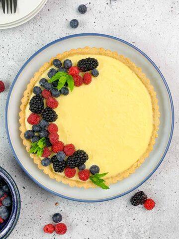 Overhead view of Lemon Curd Tart with fresh berries