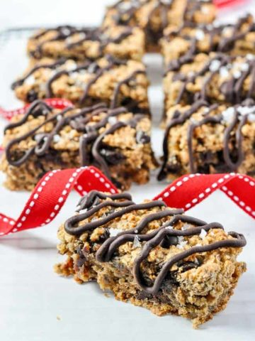 Chia Bar drizzled with chocolate and a red ribbon