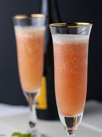 Two glasses of Rhubarb Bellini with Prosecco in champagne flutes