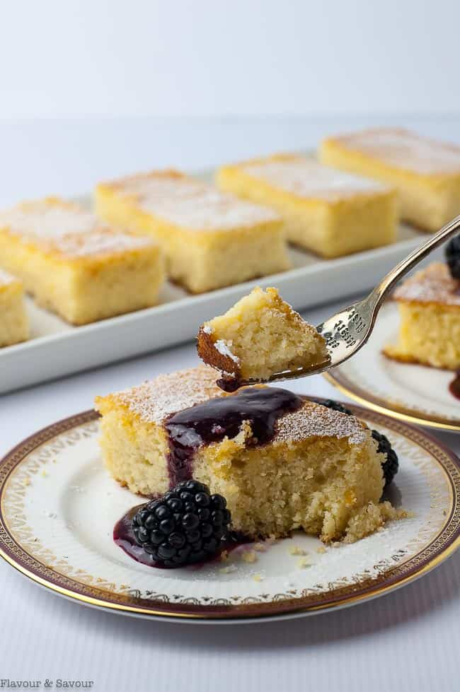 a forkful of Flourless Lemon Almond Ricotta Cake with Blackberry Coulis